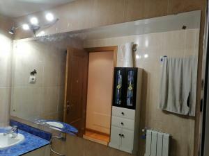 espejo de baño con aumento incorporado